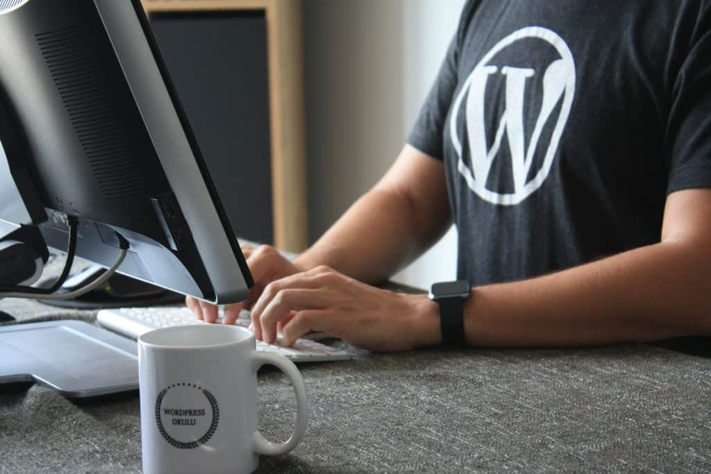 Wordpress website developer wearing a WordPress Tshirt