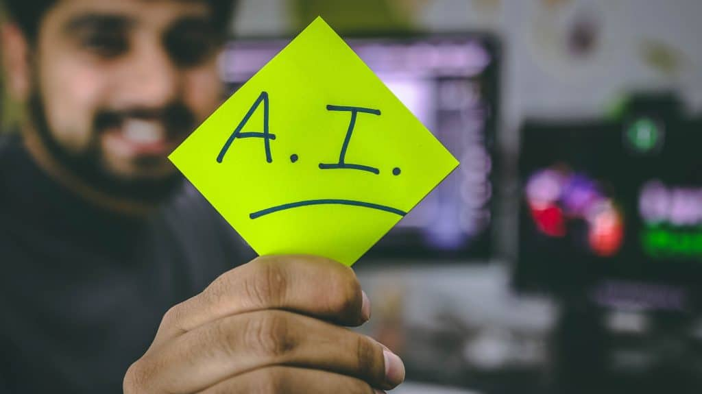 Artificial Intelligence abbreviated in a post it note as AI